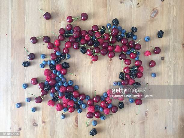 Directly Above Shot Of Various Fruits Arranged In Heart Shape On Table