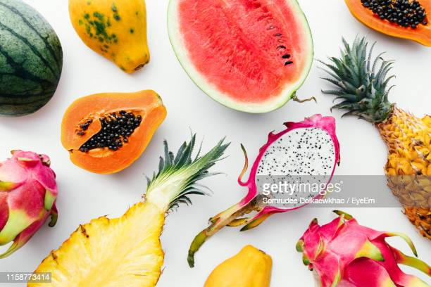 directly above shot of various fruits on white background - tropical fruit stock pictures, royalty-free photos & images