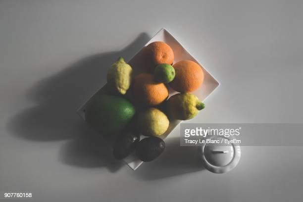 Directly Above Shot Of Various Fruits On White Table