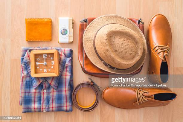 directly above shot of various objects on table - leather belt stock pictures, royalty-free photos & images