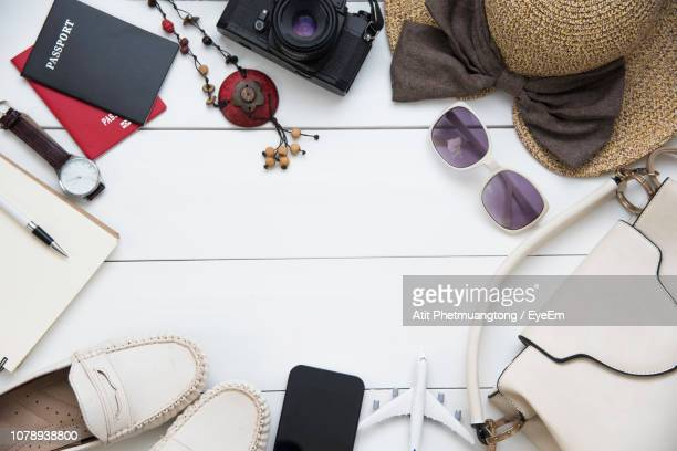 directly above shot of various objects on table - wrist watch stock pictures, royalty-free photos & images