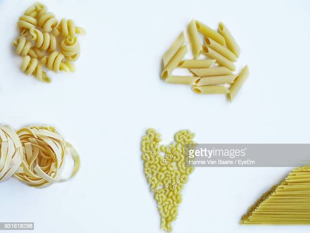 Directly Above Shot Of Various Pastas Against White Background