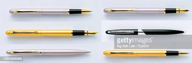 directly above shot of various pens arranged on white background - fountain pen stock pictures, royalty-free photos & images