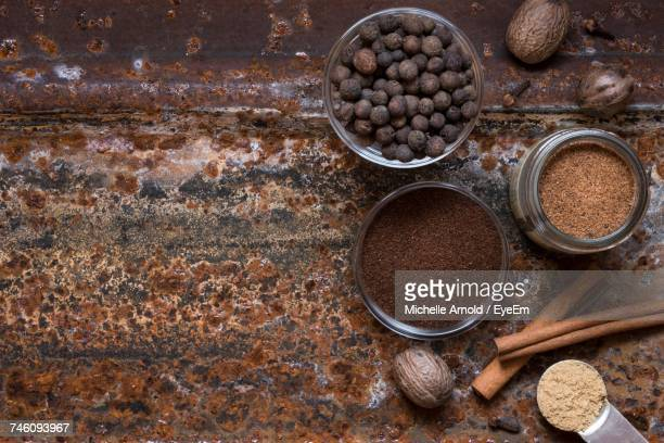 Directly Above Shot Of Various Spices On Rusty Table