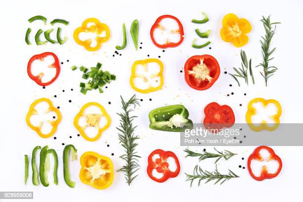 directly above shot of various vegetables over white background - yellow bell pepper stock pictures, royalty-free photos & images
