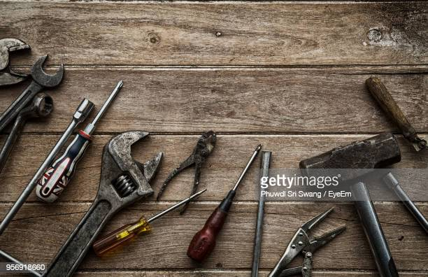 Directly Above Shot Of Various Work Tools On Table