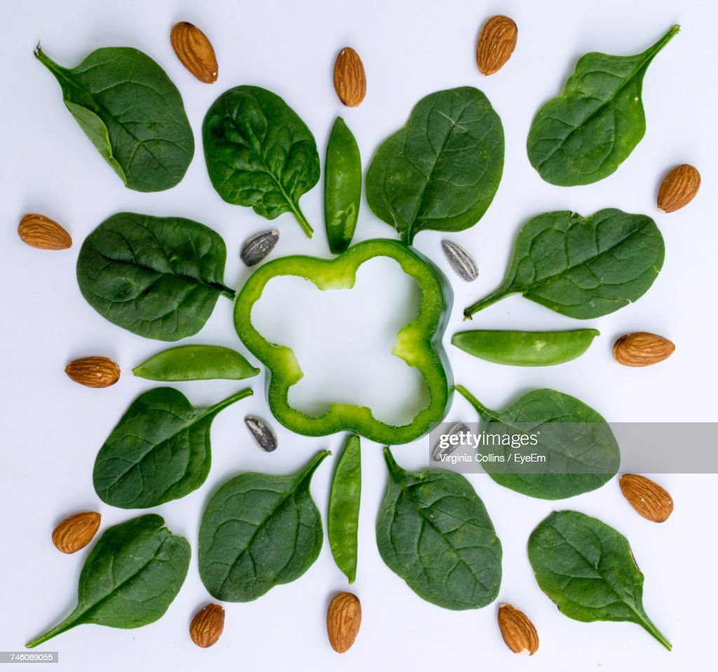 Directly Above Shot Of Vegetables And Almonds Arranged Over White Background : Stock Photo