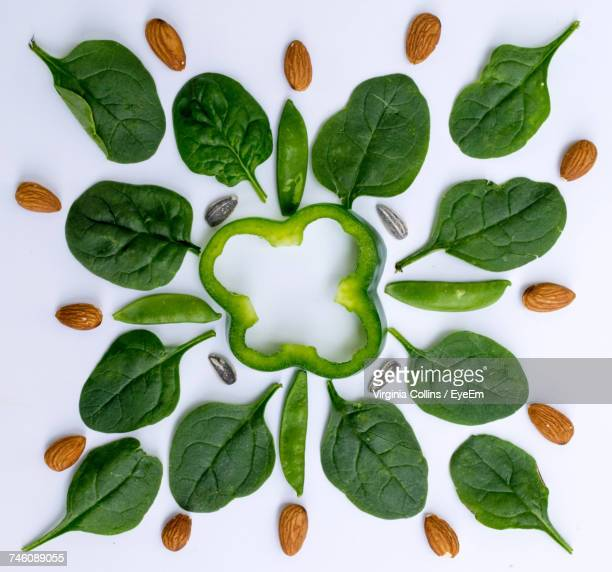 Directly Above Shot Of Vegetables And Almonds Arranged Over White Background
