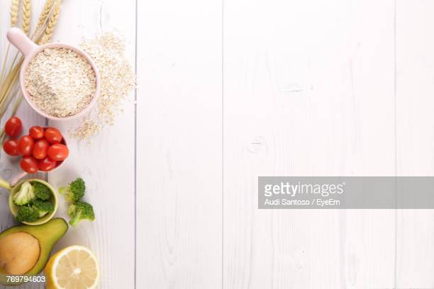 directly above shot of vegetables and grains on table - white wood stock pictures, royalty-free photos & images