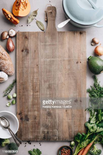 directly above shot of vegetables by cutting board - cruciferae fotografías e imágenes de stock