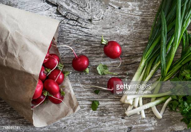 directly above shot of vegetables on wooden table - igor golovniov stock pictures, royalty-free photos & images