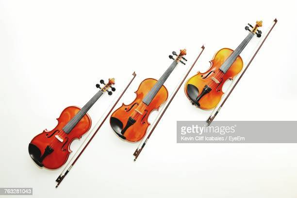 directly above shot of violins on white background - string instrument stock photos and pictures