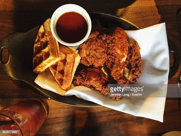 directly above shot of waffles with fried chicken and coffee in plate - chicken and waffles stock photos and pictures