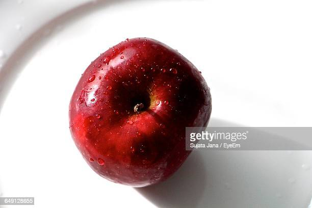 Directly Above Shot Of Wet Red Apple In Plate