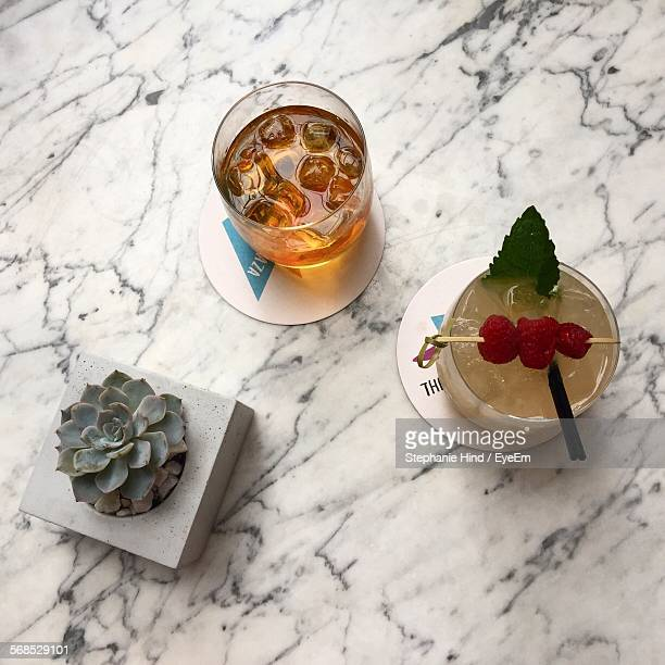 Directly Above Shot Of Whisky Served With Cocktail On Table