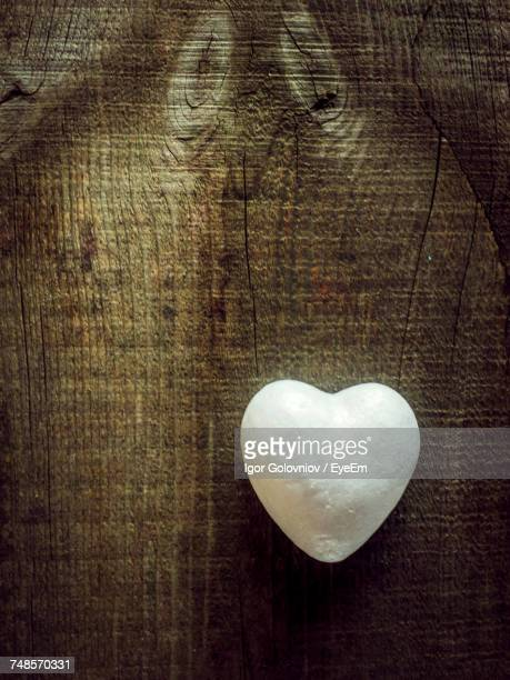 directly above shot of white heart shape on wooden table - igor golovniov stock pictures, royalty-free photos & images