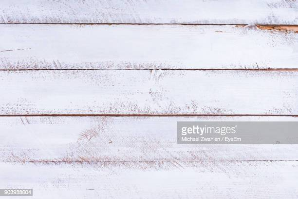 Directly Above Shot Of White Paint On Wooden Table