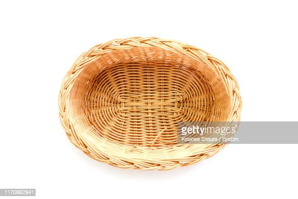 directly above shot of wicker basket against white background - wicker stock pictures, royalty-free photos & images