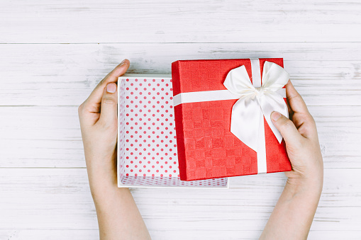 Directly Above Shot Of Woman Hand Holding Empty Gift Box On Table - gettyimageskorea