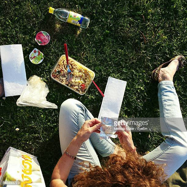 Directly Above Shot Of Woman Sitting With Pasta