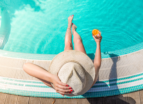 Directly Above Shot Of Woman With Drink Sitting At Poolside - gettyimageskorea