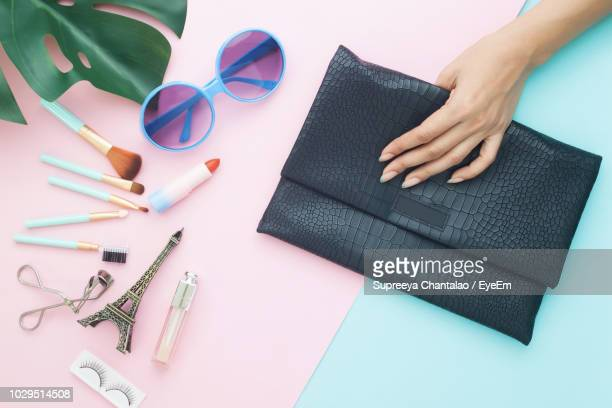 directly above shot of woman with purse beauty products on table - personal accessory stock pictures, royalty-free photos & images