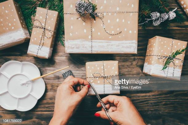 Directly Above Shot Of Woman Wrapping Gifts At Table