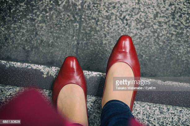 directly above shot of womans feet - stiletto stock pictures, royalty-free photos & images
