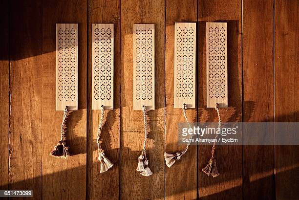 Directly Above Shot Of Wooden Bookmarks On Table