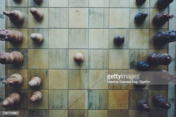 directly above shot of wooden chess board with pieces - strategy stock photos and pictures