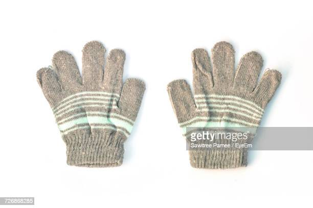 Directly Above Shot Of Woolen Gloves On White Background
