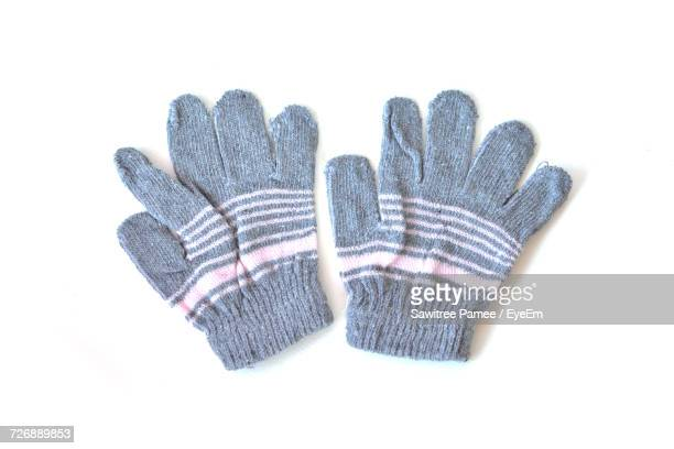 Directly Above Shot Of Woolen Gloves Over White Background