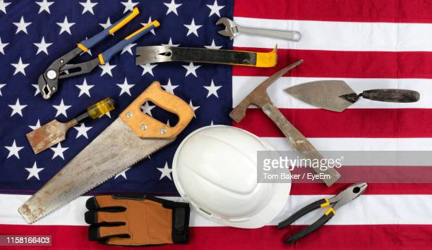 directly above shot of work tools and hardhat on american flag - dia do trabalhador - fotografias e filmes do acervo