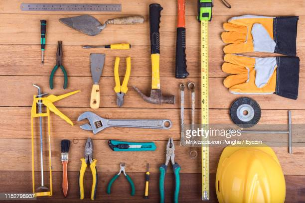 directly above shot of work tools on table - work tool stock pictures, royalty-free photos & images