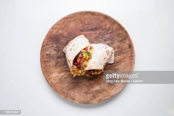 directly above shot of wrap sandwich on table - burrito stock pictures, royalty-free photos & images