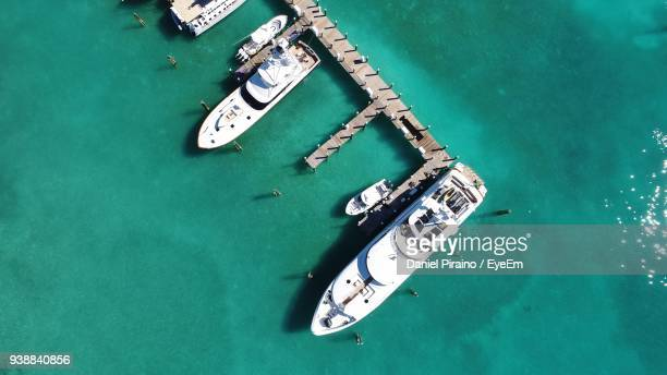 directly above shot of yachts moored in sea - harbor island bahamas stock photos and pictures