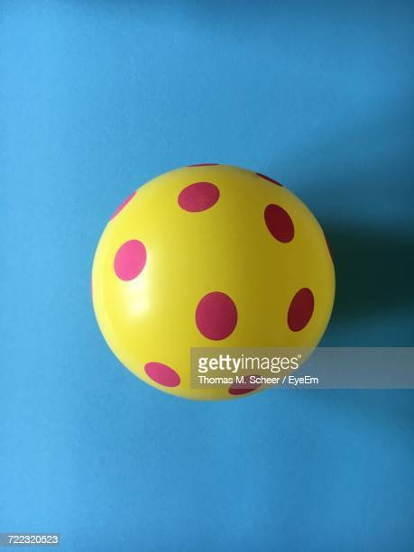 Directly Above Shot Of Yellow Balloon On Blue Background