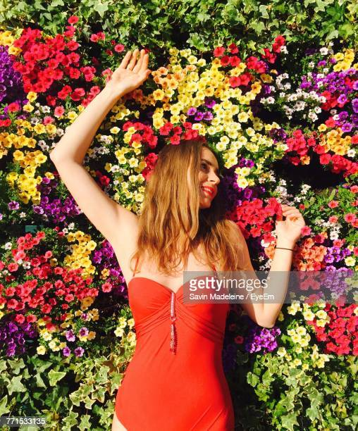 directly above shot of young woman lying on flowering plants - lady madeleine stock-fotos und bilder