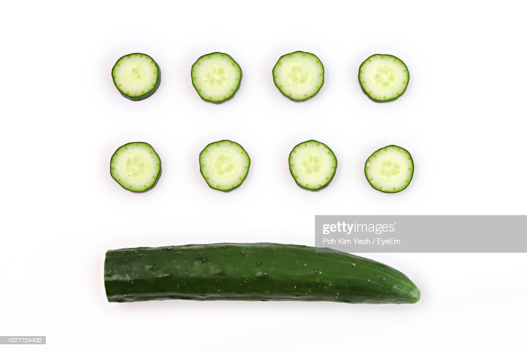 Directly Above Shot Of Zucchinis On White Background : Stock Photo