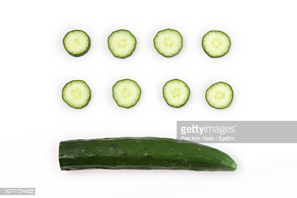 directly above shot of zucchinis on white background - cucumber stock pictures, royalty-free photos & images