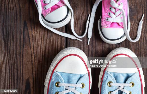 directly above shot on shoes on table - flat shoe stock pictures, royalty-free photos & images