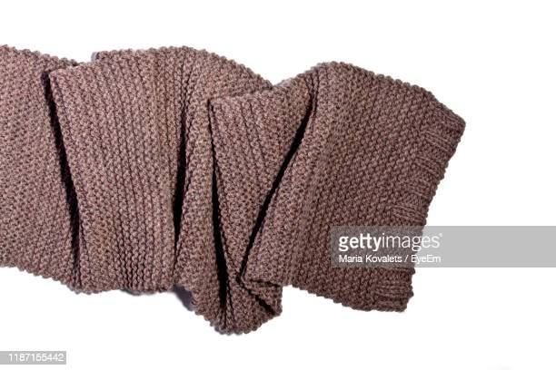 directly above shot woolen scarf on white background - scarf stock pictures, royalty-free photos & images
