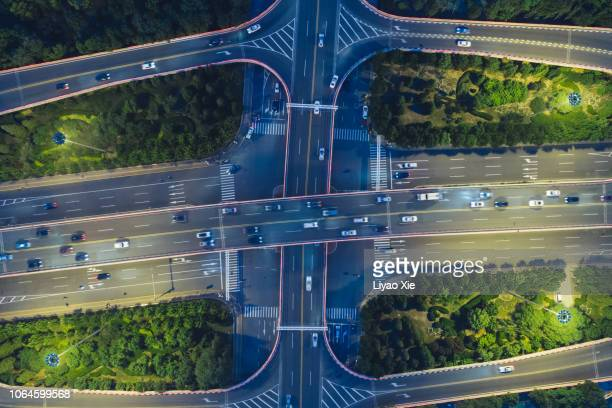 directly above the road junction - liyao xie stock pictures, royalty-free photos & images