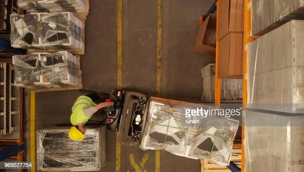 directly above view of a forklift in a warehouse of a factory - distribution warehouse stock pictures, royalty-free photos & images