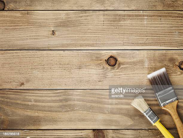 Directly above view of a wooden table and paint brushes
