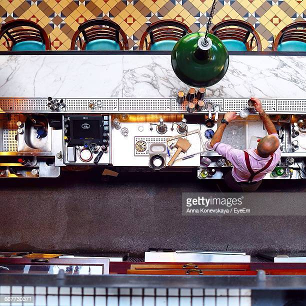 Directly Above View Of Bartender Standing By Counter At Nightclub