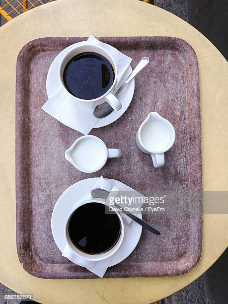 Directly Above View Of Black Coffee In Tray On Table