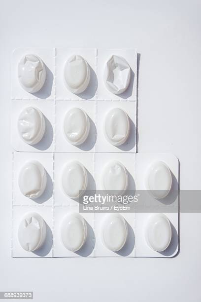 Directly Above View Of Blister Pack On White Background