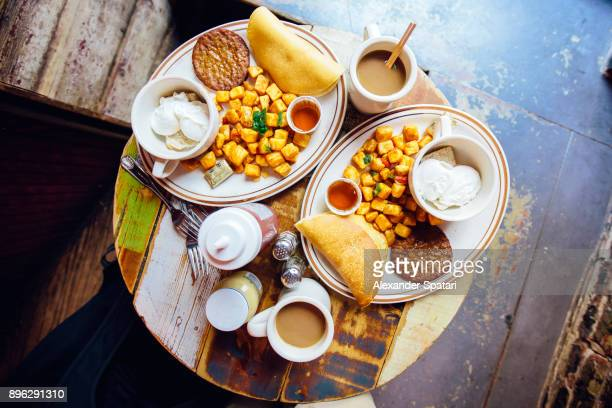 Directly above view of breakfast on the table served for two people