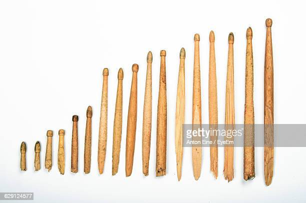 directly above view of broken old drumsticks on white background - drumstick stock photos and pictures
